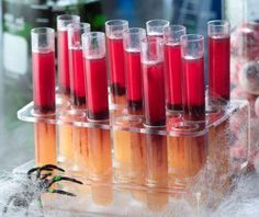Blood test tube shots. Fill them with anything you want, fruit punch, jello shots, you can even throw in some little gummy spiders to add some extra spook to it.