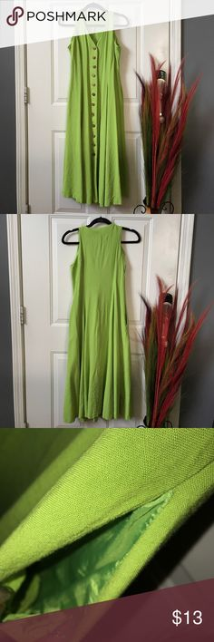 Vintage Green Dress 12 wooden buttons down the middle. 46 inches long. Has a pocket on both sides. Does have signs of wear on the inside but not noticeable with dress on. Claude Rene' Dresses