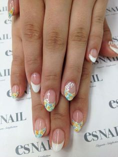 Wondering what French manicure could fit your nicely ova shaped nails? Try this floral and gold glitter ensemble. The nails are coated with clear polish as the base then tipped with thick white polish. On top of the French tips are cute little blue and yellow flowers with a thin line of gold glitter across the inner French tip lining.