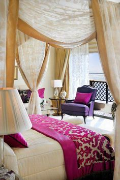 Sexy bedroom with bold magenta accents.