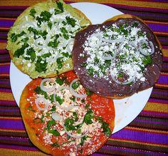 Healthy Tostadas Guatemaltecas, one guacamole, one black bean, one read sauce.