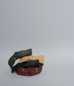 TheJany Leather Ribbon Knot HeadbandKeep the hair of your child neat while maintaining her look with beauty and youth with this headband. It comes with leather material and ribbon knot accent. Finish your child