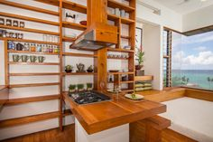 The kitchen with built in shelves.