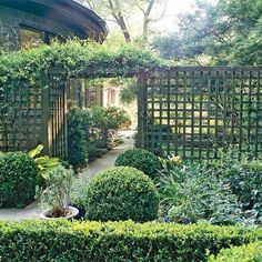 arbor with gate and fence would be lovely   for the garden space between the two houses, with a winding path leading to the   sunroom.