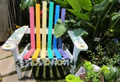 Who wants this rainbow-striped Adirondack chair from the Camden Children's Garden display at the 2012 Philadelphia Flower Show?! We love it! #garden #outdoors #colorful