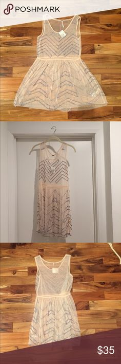 Pink Free People mini embellished slip dress This is a sheer sequined slipdress from Free People.  Looks great over a nude slip.  The tag says that it's peach but I'm 98% convinced that it's pale pink.  Never been worn.  Extra sequins included.  Handwash only and line dry. Free People Dresses