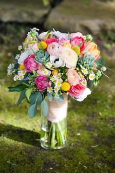 Colorful Bridal Bouquet. Pink, green, yellow, white, peach, mint. Succulents, anemones, chamomile, eucalyptus, kumquats, ranunculus, tulips, roses, billy balls. Florals by Jenny//Janet Wheeland Photography