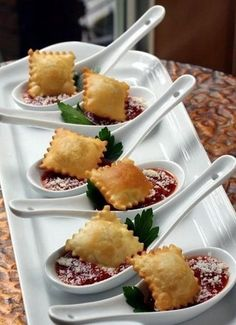 Use Sean Patrick's Toasted Ravioli appetizers and plate on marinara with grated Parmesan.