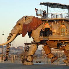 Mechanical elephant ~ is the work of Francois Delaroziere who was asked to make it as a celebratory token for the death of Jules Verne. It needs as many as twenty two people who pull and push a combination of hydraulic levers and buttons to be able to control the mammoth machine and make it move. The strange bit is the fact that the mechanical beast can actually imitate a real elephant and spray water from its huge mechanical trunk.