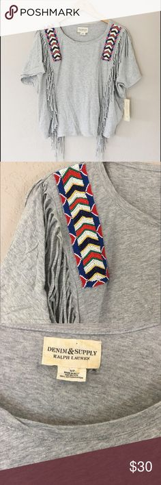 Ralph Lauren Beaded Tribal Top Brand new with tags. Tribal style beading with fringe. A few things to know:  ▫️I'm open to reasonable offers ▫️No holds, first come first serve. ▫️No  trades, No offline transactions. ▫️Please, ask any questions you may have!  Happy Poshing! Ralph Lauren Tops Tees - Short Sleeve