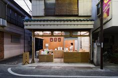 schemata architects has transformed an existing building into a small rice store, intended to stimulate activity along a once prosperous shopping street. Tokyo Shopping, Shopping Street, Architecture Design, Amazing Architecture, Contemporary Architecture, Japanese Architecture, Shop Front Design, Store Design, Cafe Design