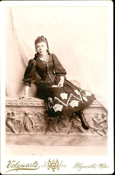 """""""Gypsy"""" Fortune Teller Cabinet Card, her short skirt marks her image as show-women as normal ladies would never be so bold as to bear their ankles.  Also her gown is decorated with cards indicating a costume more so than regular garments."""