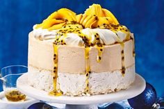 Passionfruit mango pavlova ice cream cake This is one summer showstopper that's guaranteed to please. Köstliche Desserts, Frozen Desserts, Delicious Desserts, Summer Desserts, Ultimate Cake Recipe, Cake Pan Sizes, Pavlova Cake, Cream Cake, Recipes