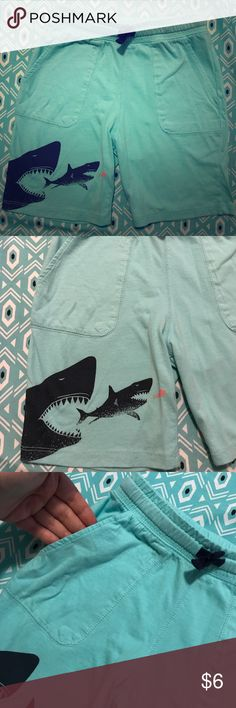 H&M shark shorts-boys 7-8 Boys h&m Jersey shark shorts. In my opinion on the boys 6-7 size range. Working drawstring. Fits true to h&m sizing in my opinion. 2 pockets in front. Adorable! My son is growing out of these and school is coming so I'm selling. My son fits Size 8 pants and these are more on the 6-7 size H&M Bottoms Shorts
