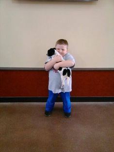 This little spotted dog adopted a wonderful boy to be all his very own today. I'm pretty sure they're both going to be very happy.