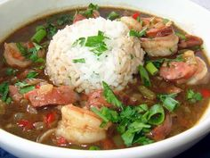 Gumbo  Ingredients 1/2 cup vegetable oil 1/2 cup all-purpose flour 1 large onion, diced 1/2 cup chopped fresh parsley 1/2 cup chopped celery 1/2 cup chopped green bell pepper 1/2 cup chopped red bell pepper 1/2 cup sliced scallion 6 cloves minced garlic 4 cups chicken broth 1 teaspoon salt 1 teaspoon creole seasoning ( Tony Chachere's) 2 lbs any combo of sausage or 2 lbs shrimp or 2 lbs chicken ( etc.)  Directions In a large stockpot combine oil and flour and cook over medium-high heat about…
