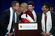 RUBBING NOSES: Tibetan spiritual leader the Dalai Lama rubbed noses with Maryland Gov. Martin O'Malley after delivering a lecture entitled 'Peace Through Compassion: Connecting a Multifaith World' at the University of Maryland in College Park Tuesday. (Nicholas Kamm/Agence France-Presse/Getty Images)