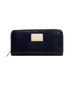 Tap into your wild side. MICHAEL Michael Kors Jet Set Python-Embossed Continental Wallet.