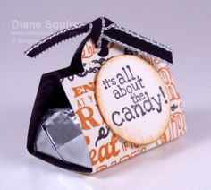 Cute little treat holder is perfect for dressing up Hershey Nuggets.  They can be made for any occasion just by changing the designer paper and ribbon - http://stampandembellish.com/2013/10/its-all-about-the-candy/
