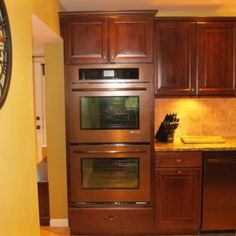 Cream Colored Kitchen Cabinets With White Appliances http