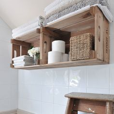 Look to the upcycling trend when considering storage. Turn wooden crates into rustic bathroom shelving by fixing the back of the crates to the wall. These are ideal for storing folded hand towels, loo rolls and baskets of toiletries.