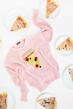 Crochet a slice of pizza for a plain sweater.