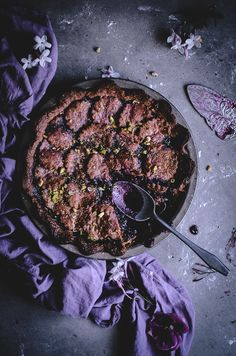 Blueberry pistachio pie with a raspberry crust