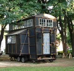 Couple leave their everyday lives to live in a $10,000 compact home made from old film sets - COOL!