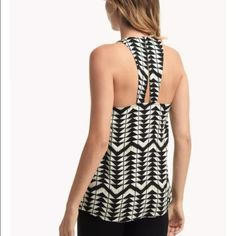 "💕HP Final Sale💕Ella Moss Zaire Tank Top All arrows point to the Zaire Tank Top. High contrast style in black and white. Deep v-neckline. Sleeveless. Shirttail hem. Back cutout detail.  Gorgeous print relaxed and flowy fit.  Brand new without tags.  Runs small at the bust for a size small.  Measurements- Bust 16"" Length 26"". Measured lying flat. Ella Moss Tops Blouses"