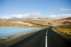A road winding past Myvatn Nature Baths, North-Eastern Iceland