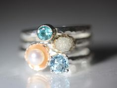 more shameless self-promotion.  Stacking rings... most are made to order.  Love this combo of rough diamond, pearl, apatite, and blue zircon.