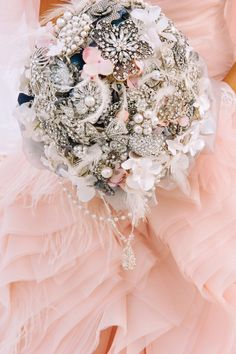 My d.i.y. Brooch bouquet that took me a whole week to make! I fell in love with the modern brooch bouquets on Etsy. But the ones I wanted were $1200-$1600.00. I spent about $500.00 on fabric, brooches and additional material. I didn't realize that brooches can be so expensive! Lesson learned! It was a great experience, but think I'll spare the job for someone else next time I get married;)