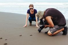 Anna & Jasyn filming baby turtle release