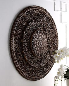 intricately carved overall floral design, Handcrafted of monkey pod wood, a tropical hardwood found in Central America and the Pacific regions :: Carved Wall Decor at Horchow