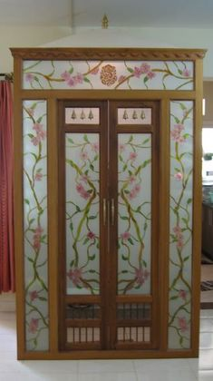 Get these pooja room designs in glass for living room or hall. Pooja room designs in glass are transparent thus allow you to view your deities from outside. Glass Pantry Door, Glass Door, Roof Design, House Design, Door Frame Molding, Mandir Design, Wardrobe Door Designs, Pooja Room Door Design, Temple Design