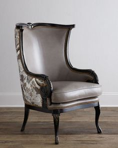 #ONLYATNM Only Here. Only Ours. Exclusively for You. Handcrafted modified wing chair. Mahogany frame. Deck, seat, and inside upholstered in leather. Outside arms and back covered in viscose/polyester.