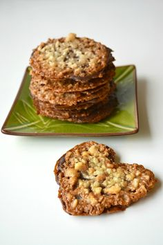 "Chocolate Macadamia Lacey Cookies recipe - ""...similar to making a toffee or brittle in some steps. It's like these cookies are really a candy disguised as a cookie! Like a brittle, you can use just about any kind of nut you want."""