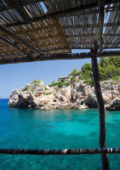 """Mallorca is an island off the coast of Spain. It was the first flight I took when people applauded when we landed. I thought, """"Didn't we expect to land safely?"""" And yes, the waters really ARE that turquoise."""