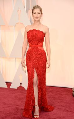 Red on red worked in Rosamund Pike's favor at the 2015 Oscars. Pike wore a rosy Givenchy gown.