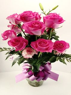 A beautiful pink arrangement, comes in either 12 stems or 18 stems, within a lavish glass vase.