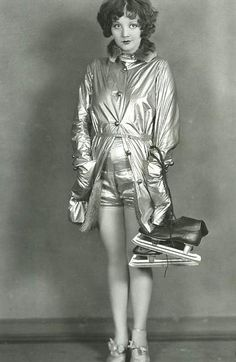 Alice White, shiny fabric, fur, and ice skates