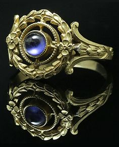 A synthetic cabochon sapphire and 18K gold ring, French, 1910-1920s.