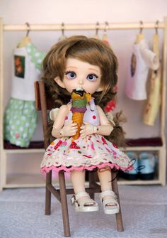 This cute white polka dots cotton dress is made for 16 cm bjd doll like Pukifee, Lati Yellow, etc. It has 3 loops with buttons and 1 snap fastener (at the bottom) at the back. There're 2 different laces at the bottom of the skirt with silk ribbon. Shoulder straps can be adjusted. There's a lining at the top. The ice cream was made by me from polymer clay.  Can be found in my ETSY store (the link is in my profile).