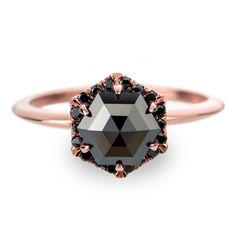 Black Diamond Rose Gold Engagement Ring, Hexagon Halo by PointNoPointStudio on Etsy https://www.etsy.com/listing/294212605/black-diamond-rose-gold-engagement-ring