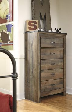 Whether she loves horses or he's a cowboy at heart, Trinell chest of drawers matches their authentic sense of style. Rustic finish, plank details and nailhead trim are an homage to reclaimed barn wood