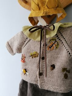 Warm linen jumpsuit with lining. Knitted wool cardigan for baby with embroidery. Linen collar with ruffles.