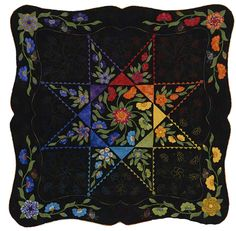 follow the link - this quilt is in the Rocky Mt. Quilt museum and the details are amazing.  The feathered star parts are decorative stitches.  Detailed mach quilting too which is amazing.