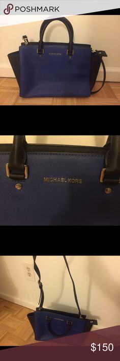Michael Kors Purse Blue and black coated leather bought at Macy's 3 years ago. In great shape not much wear! Michael Kors Bags Shoulder Bags