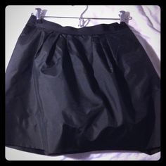 "Price drop! EUC Jcrew black taffeta party skirt 2 Perfect for winter parties, just add tights! JCrew retail black sateen fluffy mini skirt w grosgrain ribbon waist band. Fully lined and HAS POCKETS! Above the knee, length is between 16 1/2 and 16 3/4"" when laying flat. In perfect condition, barely looks worn! J. Crew Skirts Mini"