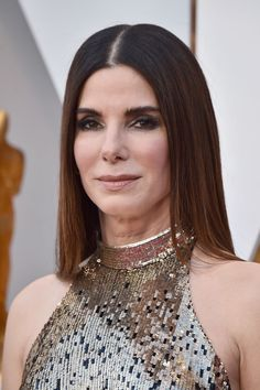 2018 Oscars - Sandra Bullock  Fluffy brows and sleek hair looked incredible on the upcoming star of Ocean's 8.